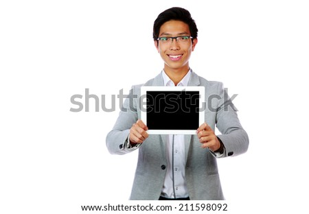 Happy asian man showing tablet computer screen over white background