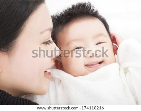 happy asian Mother and daughter or son smiling together - stock photo