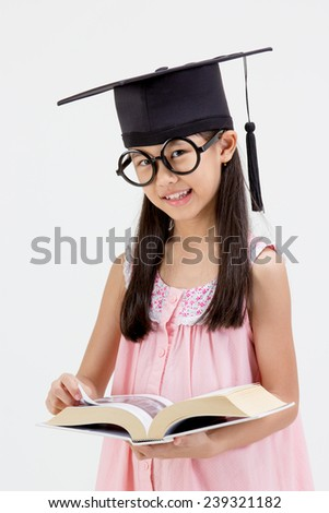 Happy Asian school kid graduate in graduation cap