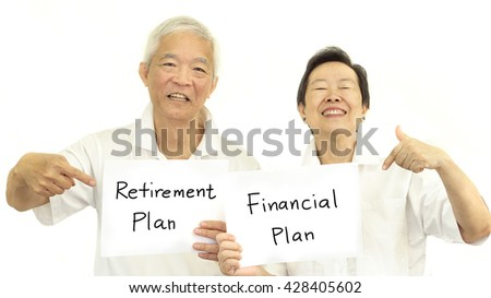 Happy Asian senior couple with sign retirement plan and financial plan - stock photo