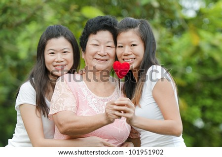 Happy Asian Senior lady and her daughters - stock photo