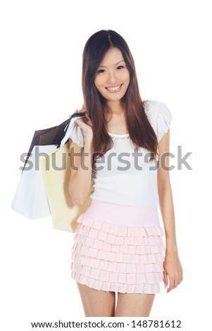 Happy Asian Shopper Holding Shopping Bag With Hand