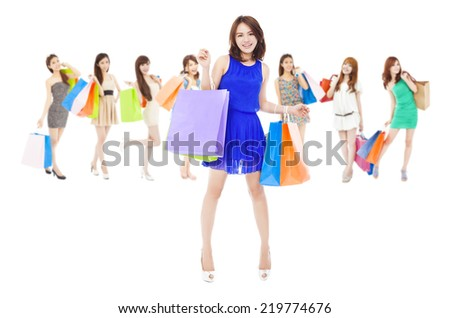 happy asian shopping women group holding color bags. isolated on white background - stock photo