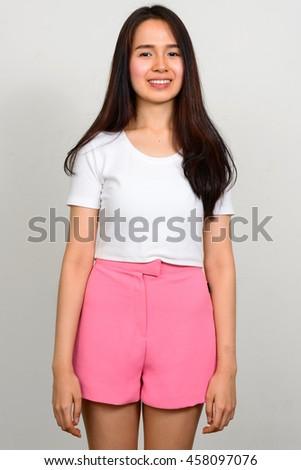 Happy Asian teenager girl - stock photo