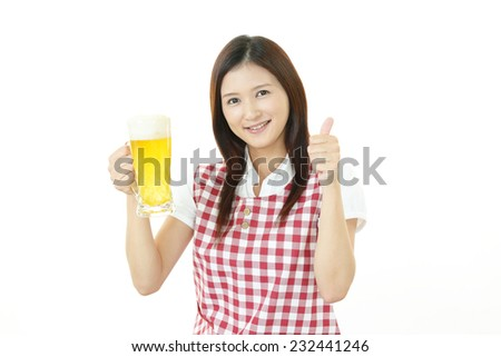 Happy Asian woman drinking beer