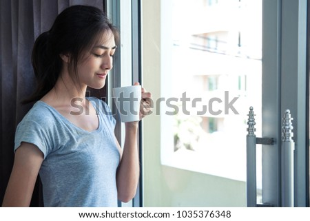 sites-up-window-asian-woman