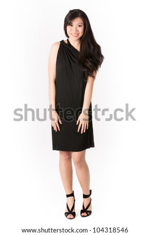 Happy Asian woman in black dress ready for night out. Isolated on white. - stock photo