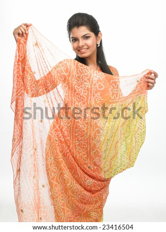 Happy asian woman in flying sari - stock photo