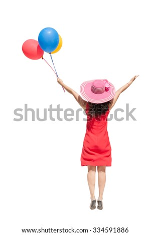 Happy asian woman jumping and holding balloons on white background. - stock photo