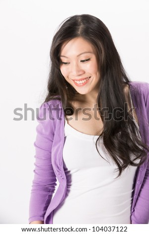 Happy Asian woman looking down. Isolated on white background. - stock photo