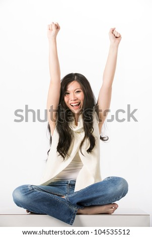 Happy Asian woman with her arms in the air cheering. Isolated on white. - stock photo
