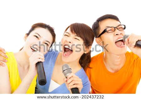 happy asian young group having fun singing with karaoke - stock photo