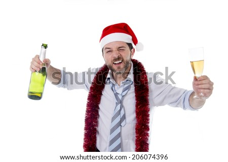 Happy attractive business man wearing santa hat with tinsel around neck in blue shirt and tie holding bottle and glass of champagne drinking at christmas party isolated on white background - stock photo