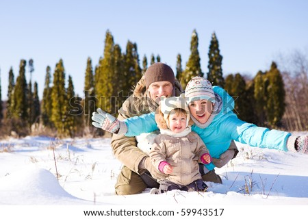 Happy attractive family having winter fun - stock photo