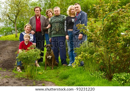 Happy, Attractive Family Pose for a Portrait Outdoors - stock photo
