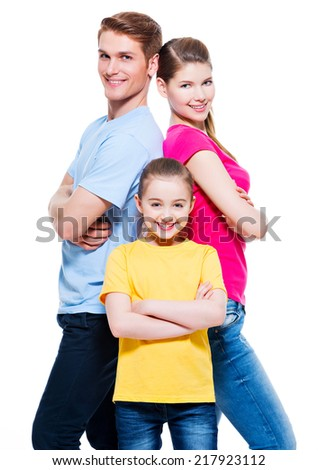 Happy attractive family with daughter standing back to back at studio - isolated on white. - stock photo