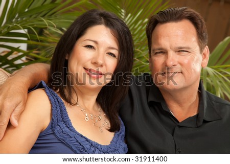 Happy Attractive Hispanic and Caucasian Couple Portrait. - stock photo