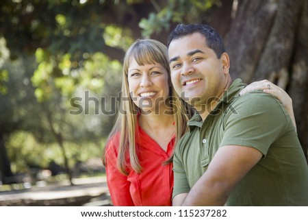 Happy Attractive Mixed Race Couple Portrait at the Park - stock photo