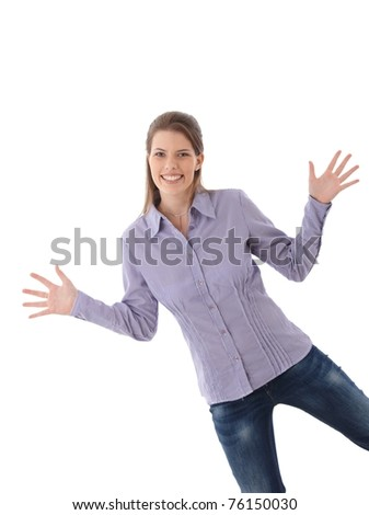 Happy attractive woman posing in studio with arms wide open, funny pose, smiling at camera.? - stock photo