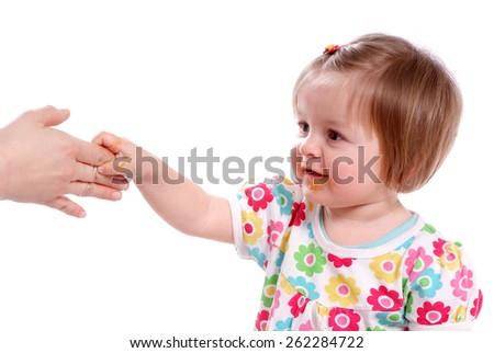 Happy baby Baby grasps his mother's hand. - stock photo