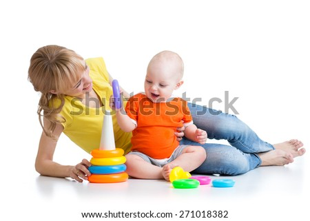 happy baby boy and mother playing together with color toy