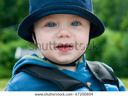 Happy baby boy looking at camera - stock photo