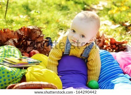 happy baby boy on sunny meadow - stock photo