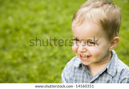 Happy Baby Boy Relaxing Outdoors - stock photo