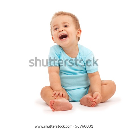 Happy baby boy sitting and laughing - stock photo