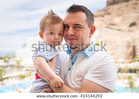 Happy baby boy with his father on holidays in Spain - stock photo