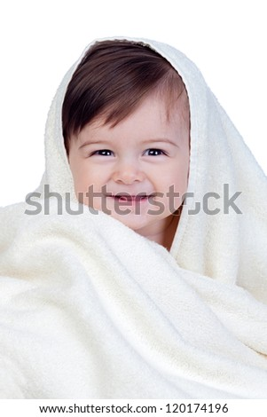 Happy baby covered with a towel isolated on white background - stock photo