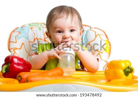 happy baby drinking from bottle