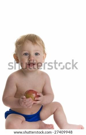 Happy Baby eats an apple - stock photo
