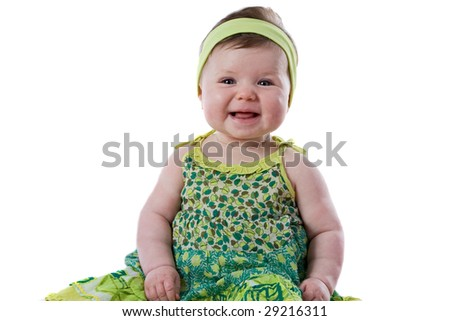 Happy baby girl smiling isolated over white