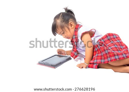 Happy baby girl using tablet computer
