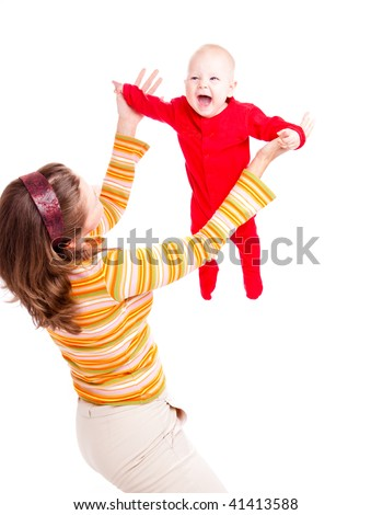 Happy baby in red flying high up - stock photo