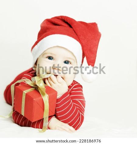 Happy baby in Santa hat - stock photo