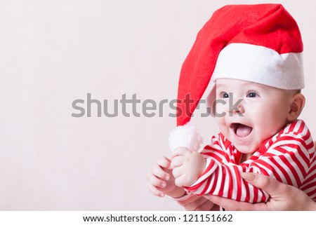 Happy baby in santa's cap