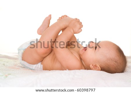 happy baby on a white - stock photo