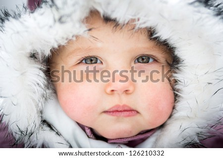 Happy baby on the winter background - stock photo