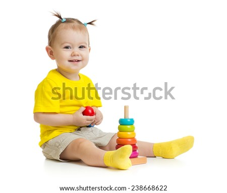 happy baby playing with colorful wood pyramid isolated - stock photo