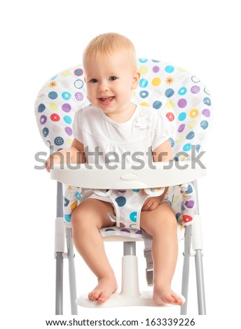 happy baby sitting in a high chair isolated on white background - stock photo