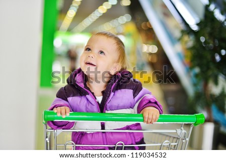 happy  baby sitting in  shopping  trolley - stock photo