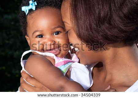 happy baby smiling at the camera - stock photo