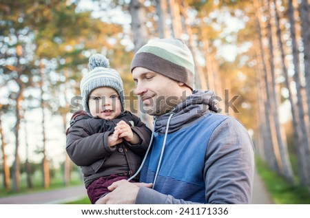 happy baby with his father outdoors in spring - stock photo