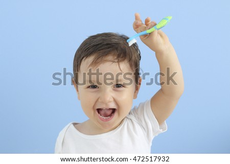 happy baby with toothbrush