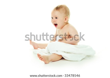 happy baby wrapped into the white towel - stock photo