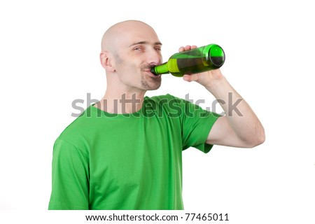 Happy bald headed man drinking beer from bottle; isolated on white background.