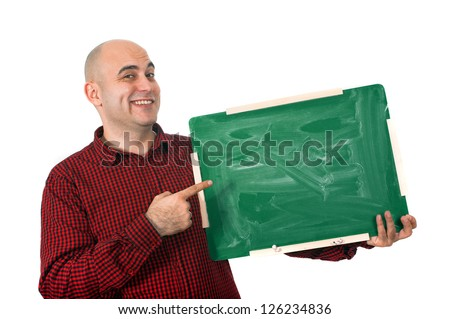 Happy bald young adult man holding a small green chalkboard.