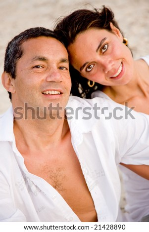 happy beach couple smiling and having fun